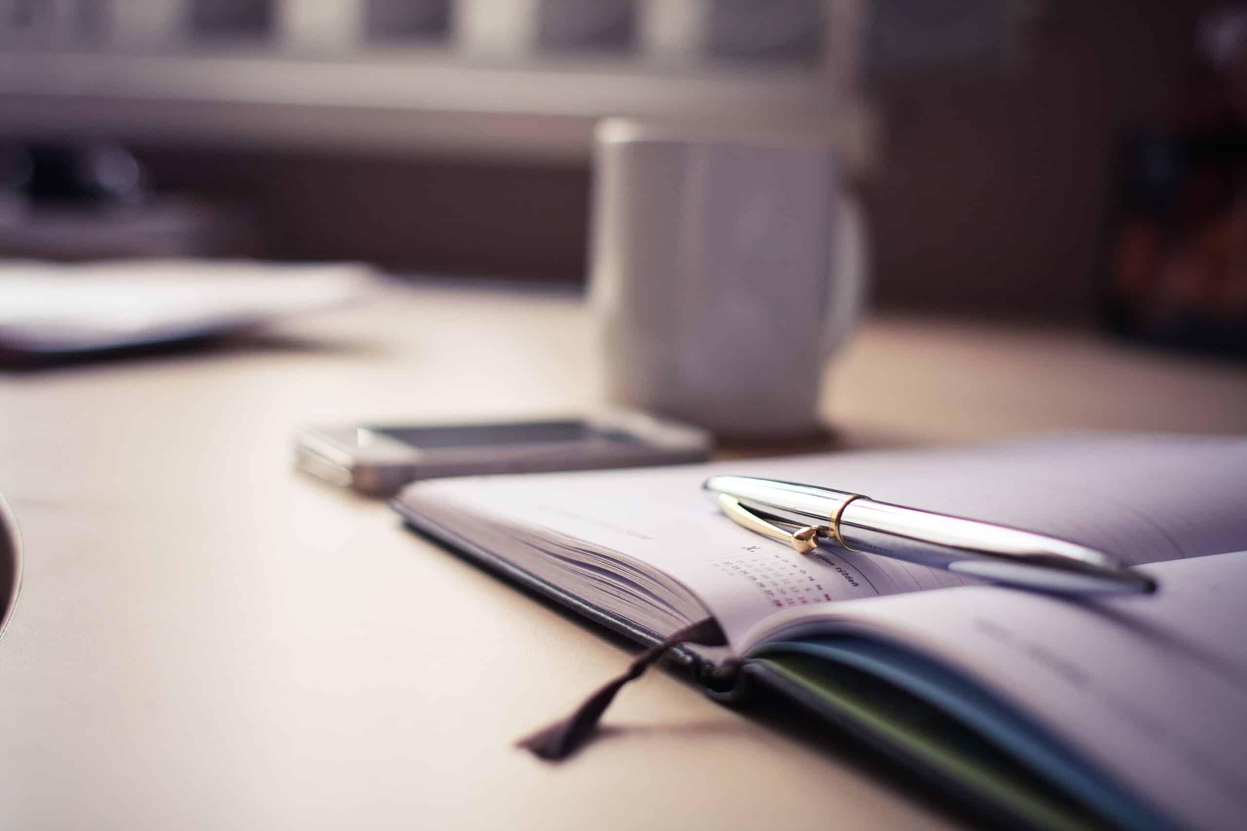 Canva - Silver Click Pen on Open Book (3)